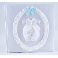Christening photo album with blue ribbon
